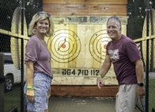 Mary, left, and MIke Ford at the Timber Ridge axe-throwing booth