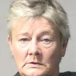 Woman charged with murder in neighbor's shooting death | Test