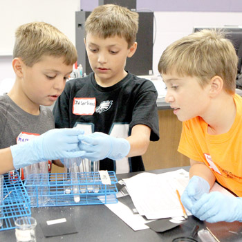 Young summer campers enjoying hands-on learning experience   Test
