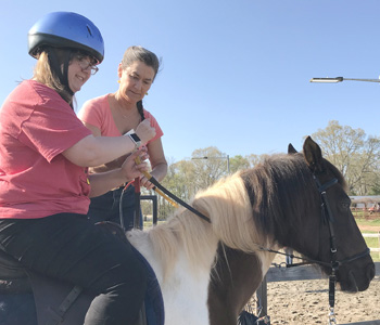 Therapeutic riding program working with students | Test