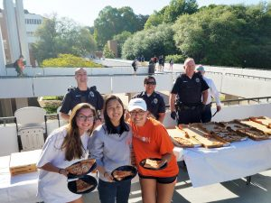 CU police give pizza to studying students