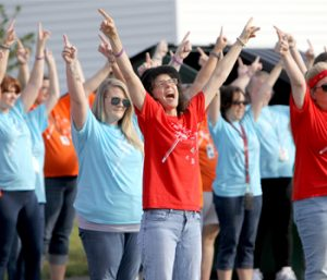 Students return to school with block party, flash mob