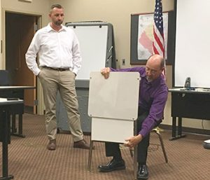 Inventors present bulletproof desk to sheriff's office | Test