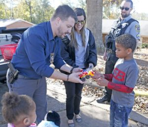 Police give away cookies, toys to build relationships