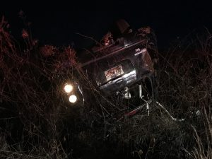 One airlifted after vehicle overturns Saturday night, driver charged