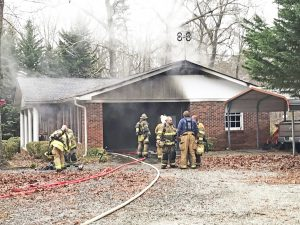 Injured man pulled from house fire