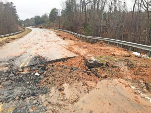 Temporary water service restored after road collapse
