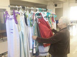 Volunteers making dresses for Haiti project