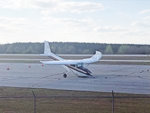 One taken to hospital after plane tips at Oconee airport