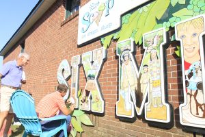 Dabo Swinney adds signature to Six Mile mural