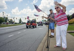 Hundreds line parade route to greet visiting service members