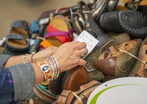 Seneca boutique donates shoes to Safe Harbor   Test