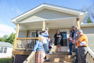 Family gets keys to new Habitat home after team effort